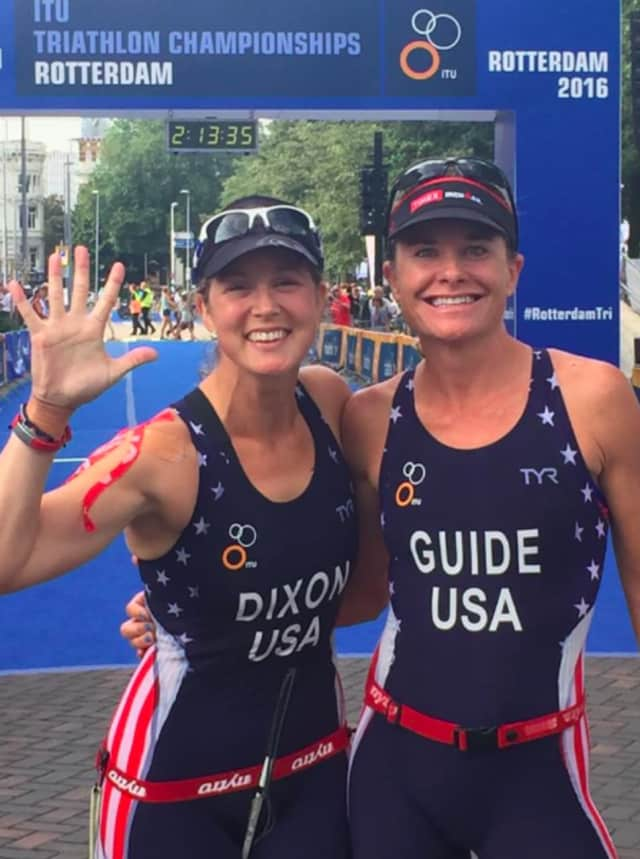 Greenwich's Amy Dixon, left, and celebrates with guide Susanne Martineau Davis after finishing fifth Sunday at the ITU World Championships in Rotterdam.