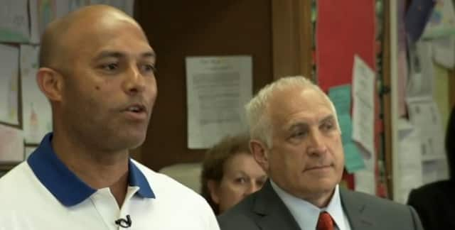 New Rochelle resident Mariano Rivera donated books and laptops to the Hamilton Elementary School library in Mount Vernon.