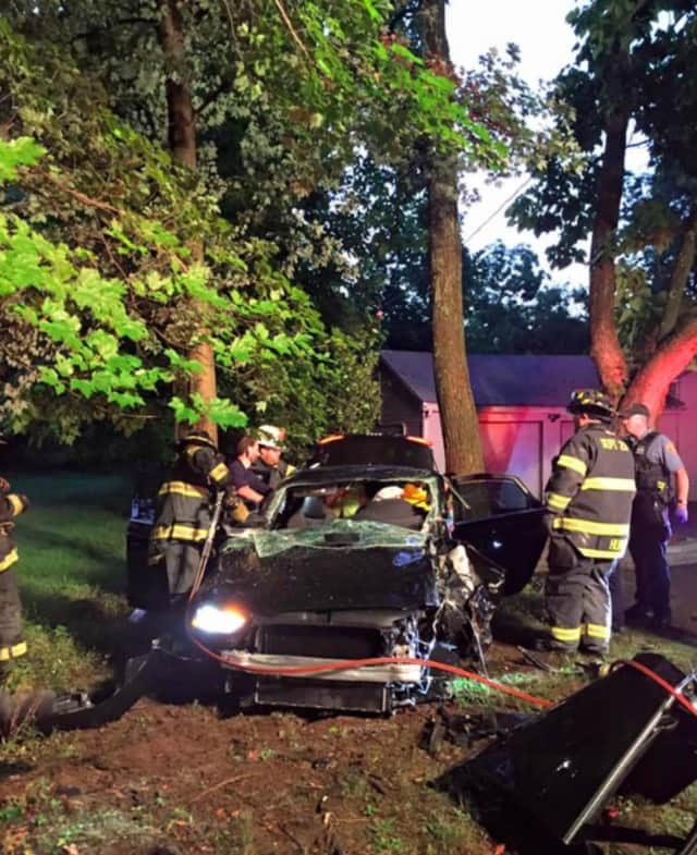 Firefighters had to remove a door and cut through the roof of the car to remove the victim.