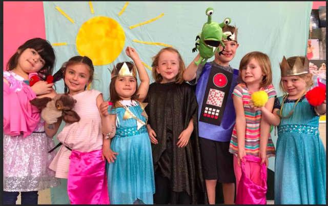 From left: Arissa Fritz, Charlotte Callahan, Norah Fritz, Natalie Treacy, James Morris, Evelyn Tie, and Quinn Morris enjoy Beginning Acting, a Kids' Theatre class.
