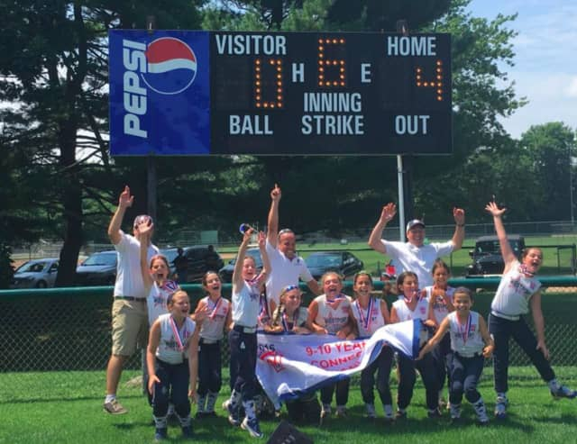 The Westport 10-and-under softball all-stars celebrate their state championship.