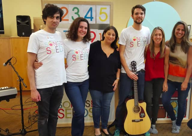 Scarsdale resident Dana Fisher in middle with black blouse with band and Songs for Seeds NYC founders.