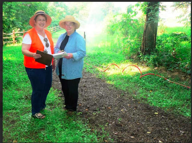 Midge Kennedy and Sarah Graver, vice-presidents of the Norwalk Land Trust, on the Wood Acre Road site.