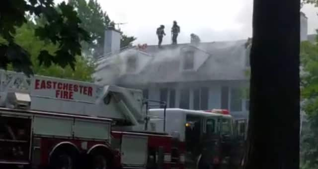 Firefighters continue to battle the two-alarm fire at an Elm Street home in Bronxville.