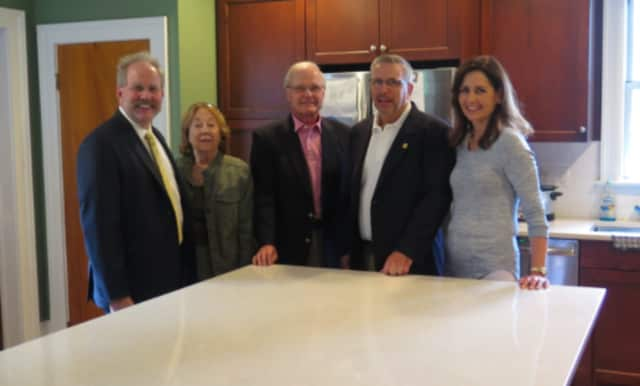 Jerry Binney, CAFS president and CEO; Trudi Dial, Woodlea/Path I Advisory Council president; David Ulrich, CEO of Ulrich, Inc.; Robert Elfers, president of Ulrich, Inc.; and Carla Fels, Advisory Council secretary, in the renovated kitchen.