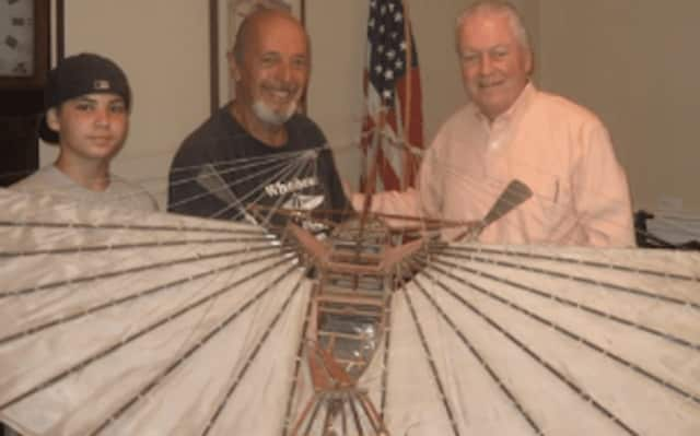 Fairfield First Selectman Mike Tetreau, right, views a replica of Gustave Whitehead's flying machine.
