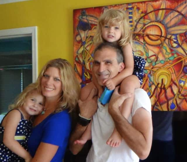 River Edge artist Kim Schmitt Thomas with her 3-year-old twins and husband.