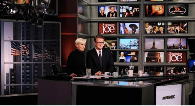 "Co-anchors Joe Scarborough and Mika Brzezinski on the set of MSNBC's ""Morning Joe."""