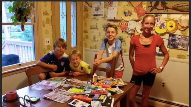 From left, Evan, 9; Aaron, 6; Ian 13; and mom, Sara Belles, with some of the back to school items they purchased