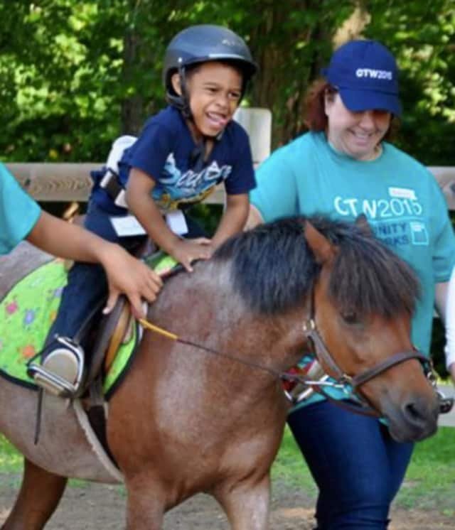 Yee-haw! A youngster takes a pony for a ride at Mahwah's Pony Power Therapies.