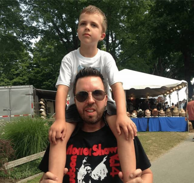 Daniel Deyo, a Yorktown native, and his son enjoy the sights and sounds of last year's fair.