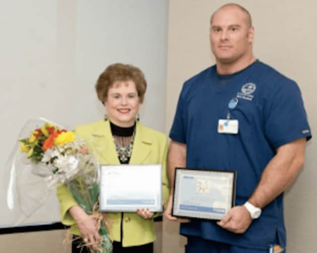 Laura Durkin of Bridgeport and Brian Sager of Branford are St. Vincent's Medical Center's Volunteers of the Year.