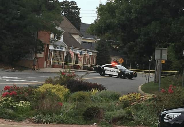 A New Castle police car is pictured next to Lange's, a popular deli in Chappaqua, following a shooting on Monday morning.