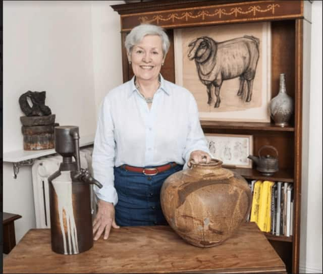 Martha Vida with a variety of pieces from her personal collection of American studio ceramics.
