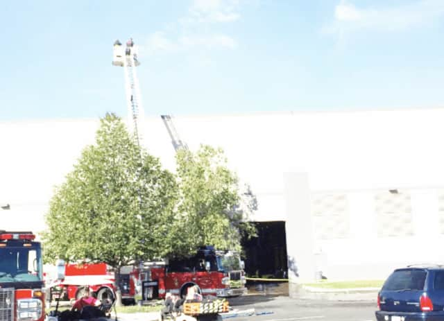 Firefighters continued to work at the Gap clothing distribution in Fishkill even after extinguishing the massive fire that broke out Monday night. Gap leaders are looking for temporary space in Dutchess County, The Poughkeepsie Journal reports.