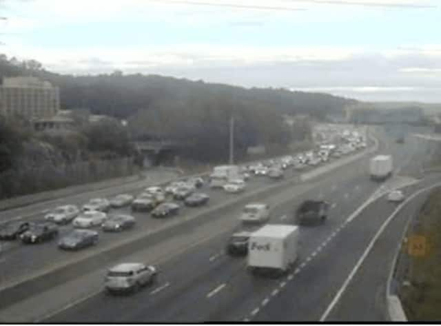 Traffic on I-287 (left) Tuesday.