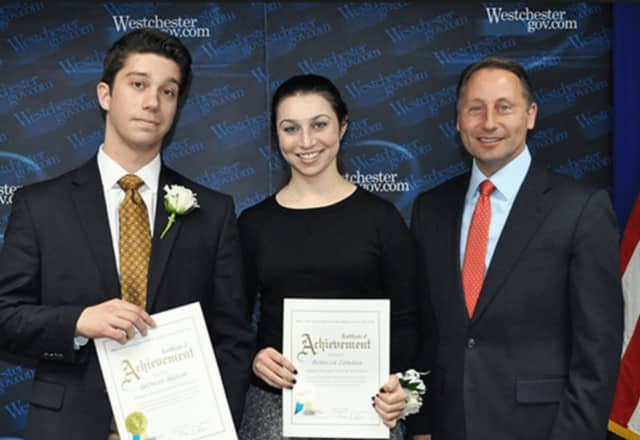 County Executive Rob Astorino, right, with two past Milly Kibrick Youth Service Award winners.