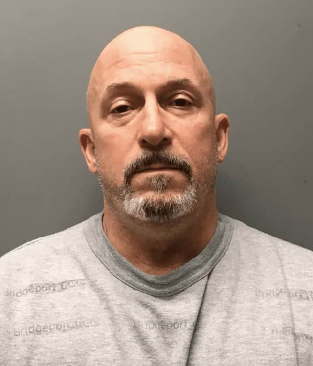 Stamford Police arrested a city man, Andrew Michaud, after he allegedly stole almost $17,000 in silver and china from the 80-year-old mother of his girlfriend.