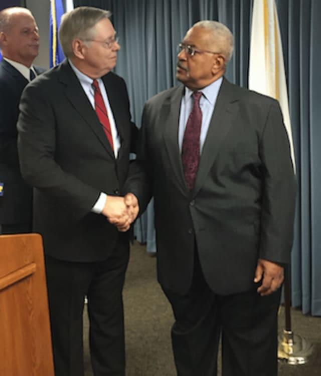 Stamford Mayor David Martin, left, shakes Bill Caillion's hand, president of Stamford Police Foundation.