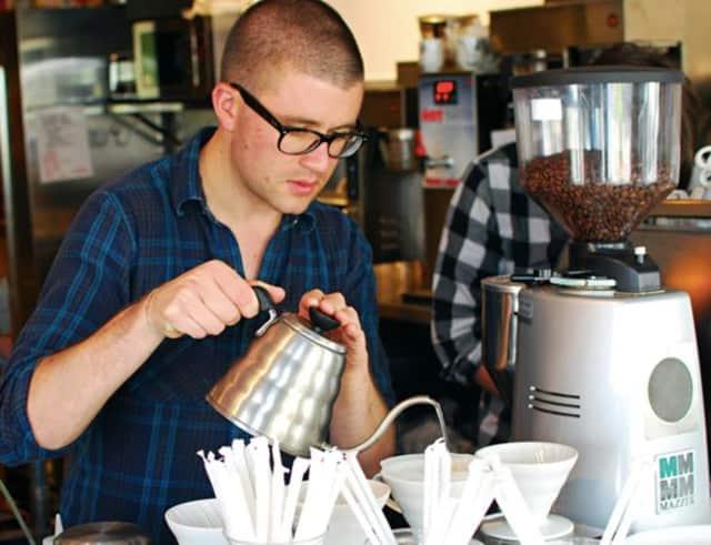 A Ridgewood Coffee Company barista prepares drinks.