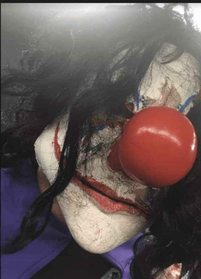 Sightings of scary clowns similar to the one seen here have been reported across the country. A clown sighted on Fairfield University's campus Monday night (not pictured) was later determined to be a prank.