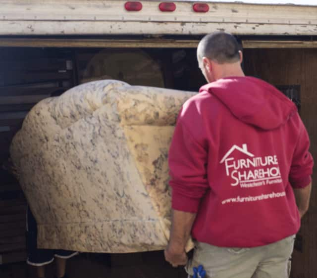 Furniture Sharehouse driver Dave Vitullo loads a sofa into a truck for one of the charity's many deliveries across Westchester.