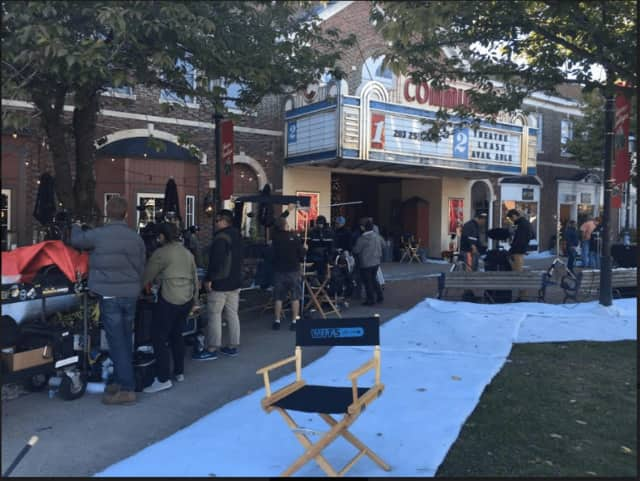 """A movie crew goes to work with outdoor filming outside the old Community Theatre in downtown Fairfield. The holiday-themed movie, """"Love In the Newsroom,"""" has also filmed in Bridgeport."""