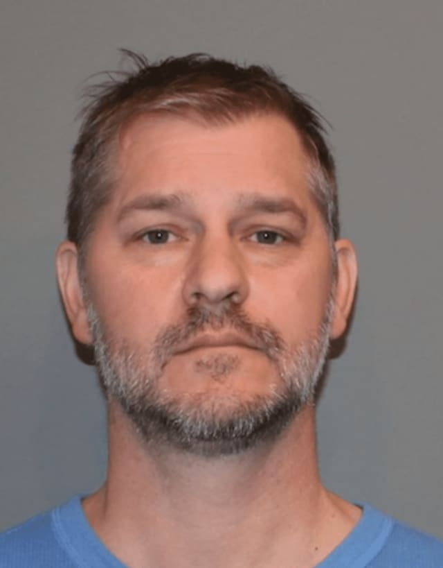 Todd Abbruzzese, 45, of 6 Garden Square, Fairfield is facing weapons charges after police discovered a pair of firearms and knives in his vehicle after he slammed into a utility pole Tuesday afternoon in Norwalk.
