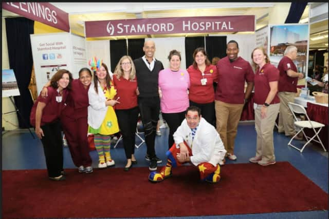 """Stamford Health representatives with Billy Blanks Jr. (center) will be at the Oct. 15-16 Fifth Annual Stamford Health """"Health Wellness & Sports Expo 2016"""" at Chelsea Piers."""