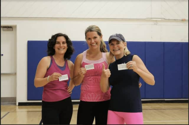 Lauren Henry, Anne Michaelis and Gay Morrissey display their FitClub Challenge scorecards during last year's challenge.