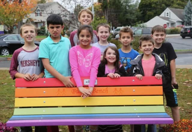 H.B. Milnes students with one of their new buddy benches.