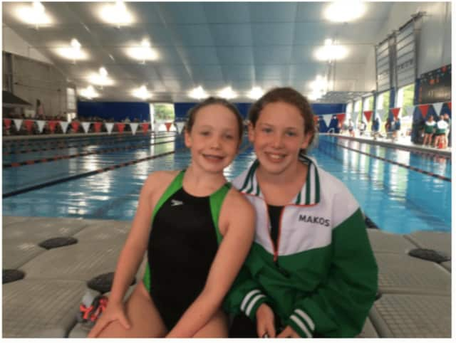 From left, Bethel girls Julia and Olivia Herbert have set up a fundraising page to raise money for their swim team at the Regional YMCA in Brookfield.