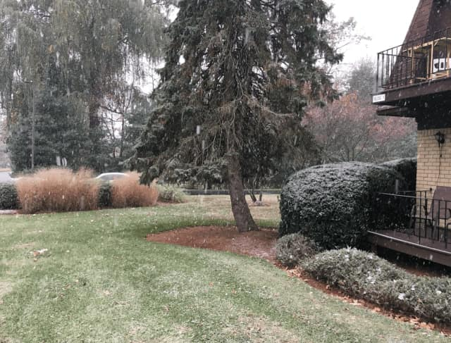 The season's first snowflakes fall Thursday morning shortly after 9 a.m. in the Town of Poughkeepsie.
