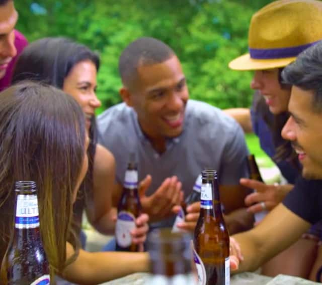 Thomas Pierce, center, is featured in the new Michelob ULTRA ad.
