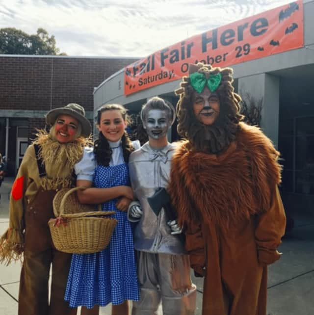 """The cast members for the New Canaan High School Theatre's production of """"The Wizard of Oz"""" at the East School Fair - From left, Sadie Seelert, Kate Murphy, Ben Dooley and Wyatt Lysenko."""