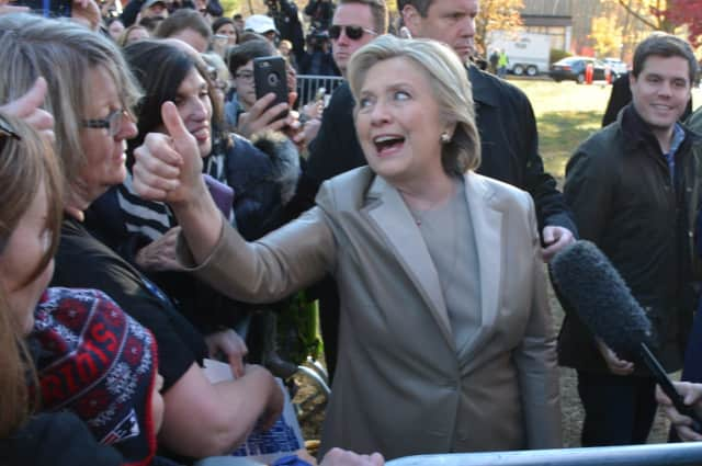 Hillary Clinton gives a thumbs up while meeting with supporters and reporters after casting her presidential vote in Chappaqua in November 2016.