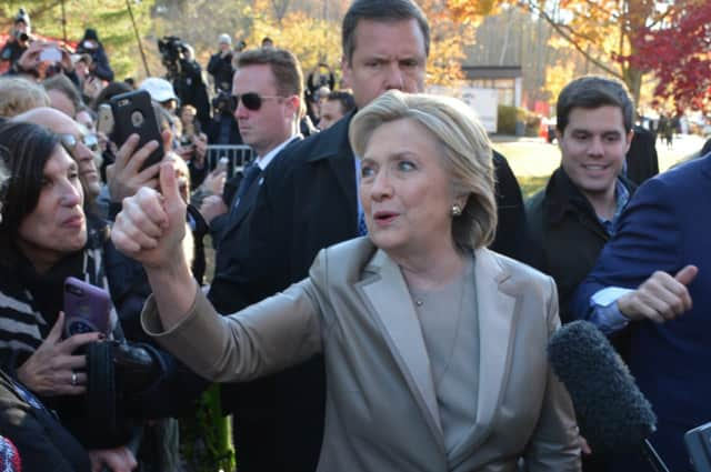 Hillary Clinton gives a thumbs up while meeting with supporters and reporters after she cast her presidential vote in Chappaqua on Nov. 8.