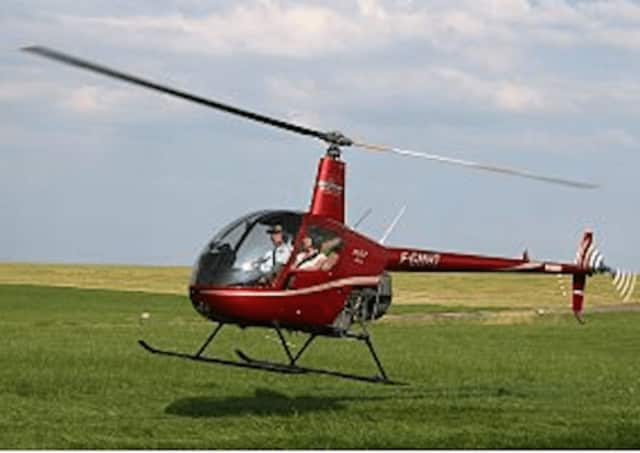A small helicopter - similar to the one pictured - spotted over downtown Stamford on Tuesday was practicing hovering, police said.