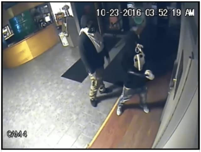 Two suspects in a burglary at a Stamford business on Oct. 23 in an image taken from a video released by the police department.