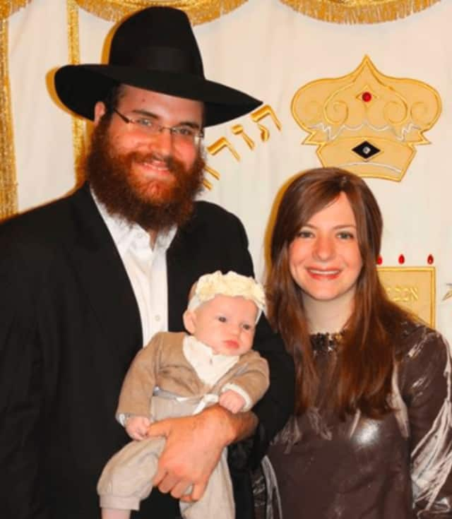 Rabbi Yosef Orenstein with his wife, Estie, and their child, of Valley Chabad in Woodcliff Lake.