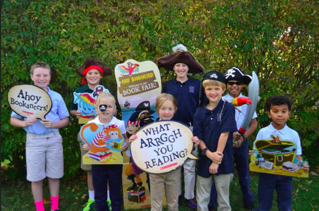 "Pear Tree Point School students dressed in pirate attire for the ""Bookaneer"" Autumn book fair - from left, Will Warnock, Hans Baurmeister, Lucy Logan, Daphne Upson, Colten Trepp, Stewart Upson, Joshua Fields and Isaiah Fields."