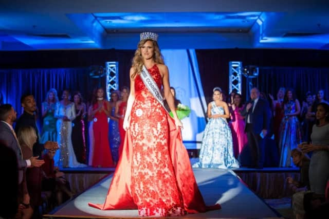 Olga Litvinenko of Greenwich steps forward as crowned Miss Connecticut USA 2017 during the weekend competition in Stamford.