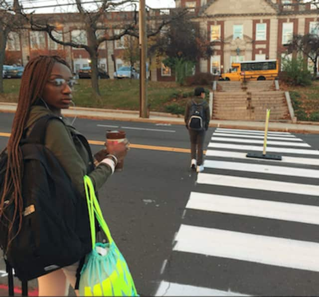 Earthaiza Watkins, at left, a junior at Stamford High School, says the new crosswalk in front of the school makes crossing the street much safer.