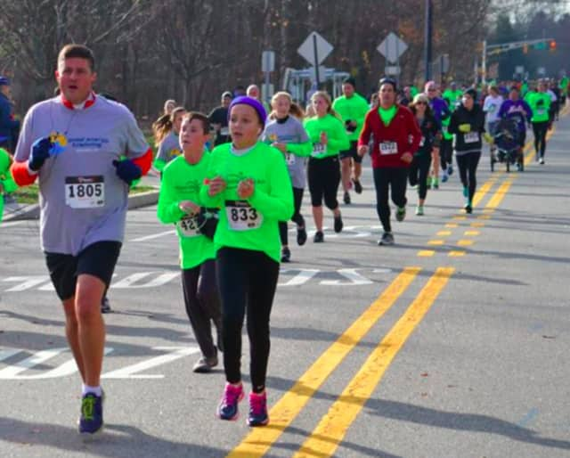 Chris and Caitlyn Kunisch Caitlyn lead the trotters down the home stretch of the annual Upper Saddle River 5K.