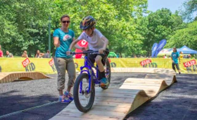 "The Clif Kid Pump Track, named for the ""pumping"" arm and leg action that occurs as young riders ride a fun loop filled with banked turns, ramps and mini rolling ""hills."""