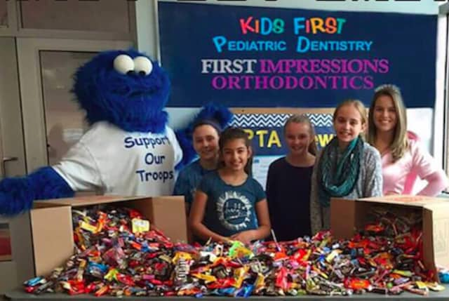 Two Fairfield fifth-graders made the day a little sweeter for hundreds of U.S. troops in the Kids First Halloween candy buy back this month.