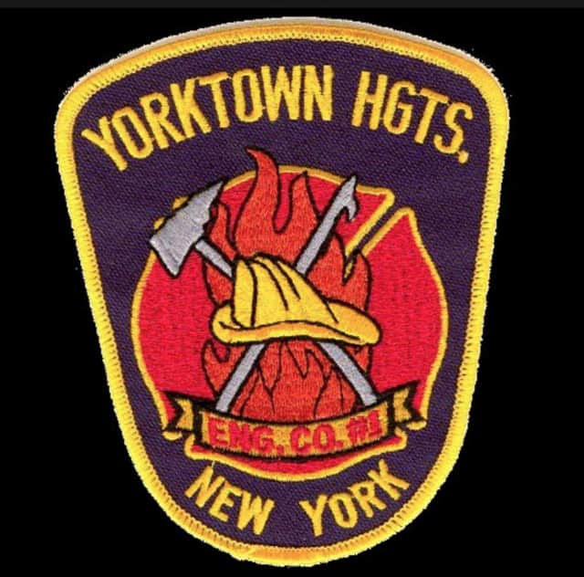 A car drove down an embankment Monday morning, requiring police and fire personnel to conduct a rope rescue of an unconscious victim, according to the Yorktown Heights Volunteer Fire Department.