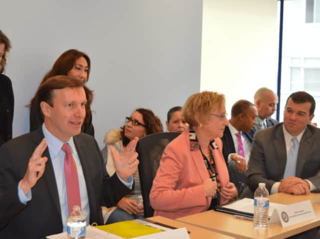 A few weeks ago, U.S. Sen. Chris Murphy, D-Conn., crosses his fingers during a Bridgeport meeting in hopes a sweeping mental healthcare bill he co-authored would be passed. The Senate passed the bill on Wednesday, 94-5.