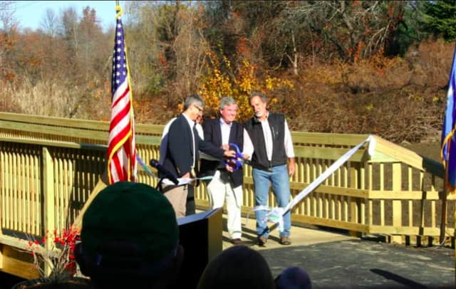 A weekend ribbon-cutting for the new Still River Greenway in Brookfield draws a crowd of about 100 people.