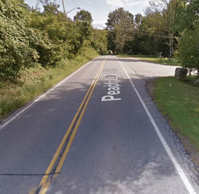 Part of the area of Peach Lake Road (Route 121) that is closed following the crash Wednesday.